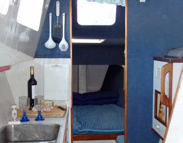 1276-galley-looking-aft-to-double-bunk
